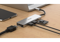 DUB-M530 5-in-1 USB-C Hub with HDMI and SD/microSD Card Reader - on a desk connected to a laptop and showing example connections