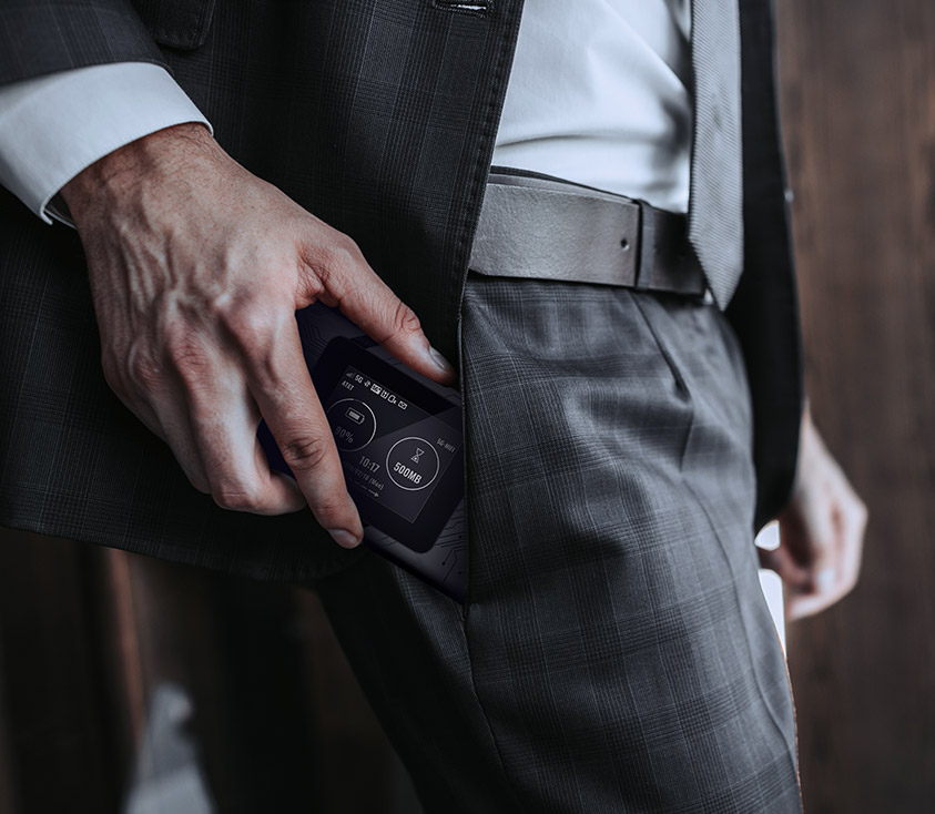 A man taking the DWR-2101 5G Wi-Fi 6 Mobile Hotspot out of his pocket.