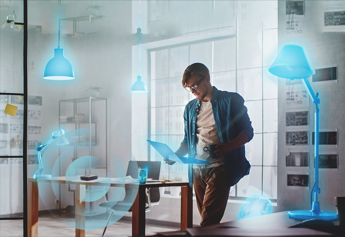 Man surrounded by smart home devices.