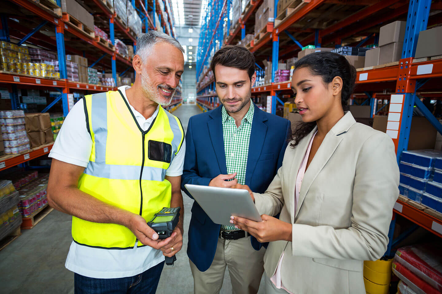 Big warehouse with people using wireless devices