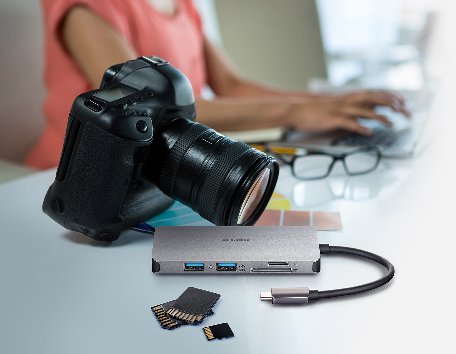 6-in-1 USB-C Hub with HDMI/Card Reader/Power Delivery next a camera and SD cards and microSD cards