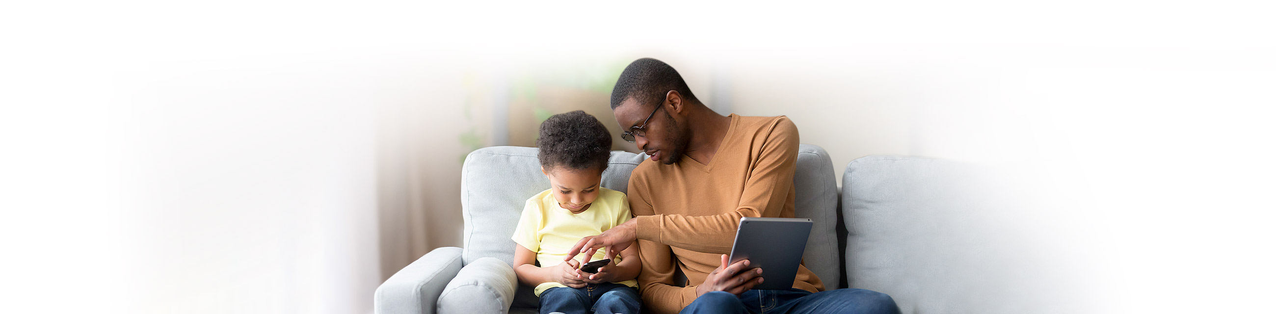 Father and son using devices
